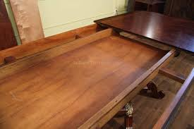 round dining room tables with self storing leaves mahogany and walnut dining room table with self