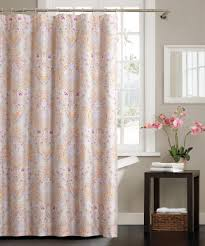 bathroom assorted color curtains on the curving silver steel ring placed on the gray wall