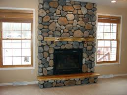 fireplace stacked stone panels tile over brick