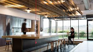 nulty berghaus hq sunderland modern sleek office kitchen glass timber communal table lighting