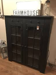 eight pane black cabinet with glass doors