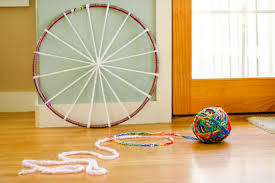 for the first project b proffered his largest ball of finger knitting for us all to try weaving a rug this finger knitting hula hoop rug is super fun and