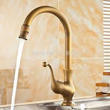 2018 deck mounted bronze kitchen sink faucets antique brass kitchen faucet 360 degrees rotated retro hot and cold mixer tap j17056 from rudelf