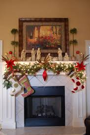 Beautiful Christmas fireplace mantel decoration with hanging-trailing vines  with red florals and cute stockings, saint statues, and beautiful plants.