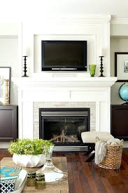 hanging a flat screen tv over a gas fireplace above fireplace really like the moulding around
