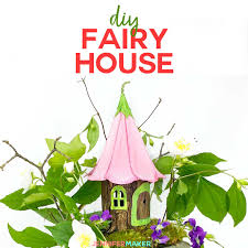 diy fairy house with a flower petal roof made entirely from paper and glue with a