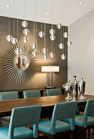 bubble light chandelier dining room midcentury with starburst mirror gray accent wall