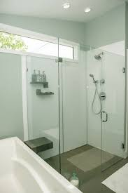 a contemporary high gloss shower wall panels system in an upscale bathroom remodeling project with a