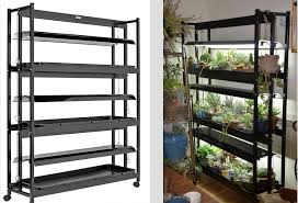 plastic drip trays and wheels for easy positioning three shelves provide 18 square feet of growing space from gardener s supply co about 600