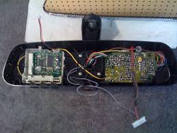 calling all homelink alarm mirror electrical experts putting car in reverse correctly un darkens the mirror the alarm module is fed a constant power signal and receives my keyfob inputs and the homelink