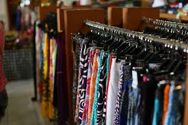 a rack of colorful clothing items