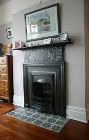Cast iron Art Nouveau bedroom fireplace. The detail has been polished. ~  Great pin