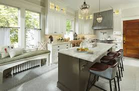 kitchen in century old home in st paul minnesota has white shaker cabinets with custom glass