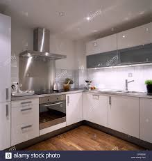 White Kitchen Wooden Floor A Modern White Kitchen With White Units Stainless Steel Integral
