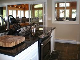 oven in kitchen island. kitchen island with stove top, oven, and bar on the other side! oven in
