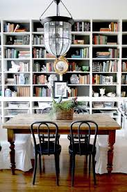 Beautiful dining room / office combination by HGTV designer Genevieve  Garder. This dining room easily functions as both a dining room and office.