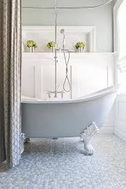 View in gallery Elegant bathroom with claw-foot bathtub and mulitcolored penny  tile flooring [From: Kelly