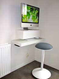 attractive modern wall mounted imac computer desk arrangement design with white color wooden computer desk and minimalist round chair