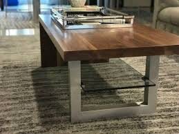 modern walnut waterfall coffee table with glass shelf and metal leg
