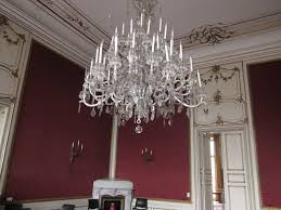 this old crystal chandelier was in nearly constant use fitted around 1980 with e10 lamp holders for a more candle lights atmosphere it had to be