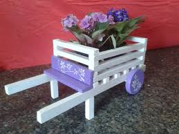 colorful pallet wheelbarrow planters