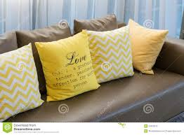 Yellow And Brown Living Room Living Room With Brown Sofa And Yellow Pillows Stock Photo Image