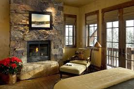view in gallery rustic bedroom turns the stone wall into a lovely focal point from design associates