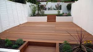 Small Picture hardwood decking rendered smooth walls white fence and modern
