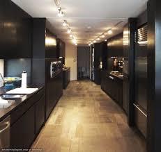 kitchen track lighting over modern black cabinet and laminate floor track lighting ideas for kitchen e91 track