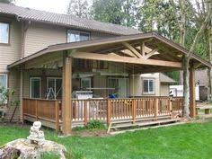 together with  in addition Best 25  Covered deck designs ideas on Pinterest   Patio deck as well Architecture  Outdoor Pool Deck And Patio Modern House Design With as well  likewise  in addition How To Build A Roof Over Existing Patio Or Deck   home improvement moreover  furthermore Design For Decks With Roofs Ideas  21571 besides  additionally Best 20  Flat roof design ideas on Pinterest   Flat roof house. on deck roof design