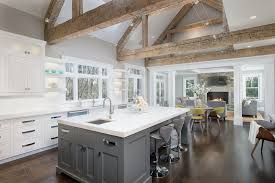 kitchen and great room designs. rustic great room with carpet, hardwood floors, cement fireplace, flush light, exposed kitchen and designs t