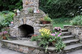eclectic stone backyard fireplace outdoor fireplace brown design group new stanton pa
