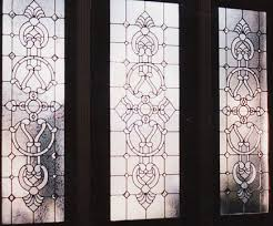 custom entry with intricate designs in door and sidelight windows
