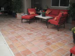 patio exterior for patio with chair and table set colored red also brick tiles patio