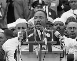 the life and legacy of martin luther king jr shareamerica martin luther king speaking into row of microphones crowd behind him acirccopy ap images