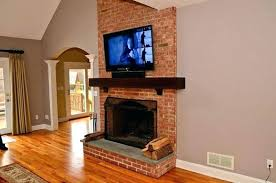 hanging tv over fireplace hanging over fireplace at hanging fireplace brick for beautiful mounting over brick hanging tv over fireplace