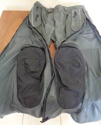a photograph showing the velcro in the knee armor pockets that allows the rider to adjust