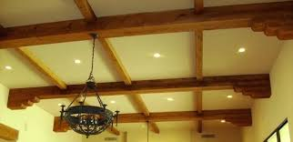 installing wood beams on ceiling faux beams these wood adornments can be installed on the ceiling installing wood beams