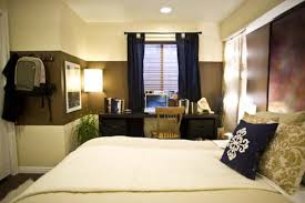 bedroom: Luxurious Basement Bedroom Ideas With Comfortable Double Bed Near  Wood Chair Front Laptop On