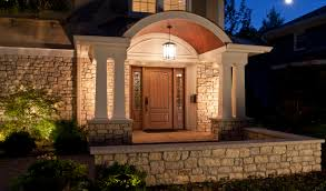 outdoor house lighting ideas. Rustic Modern House Design With Stone Wall Exterior And Mounted Lighting Combined Hanging Lamp Wooden Door Fiberglass Window Ideas Outdoor