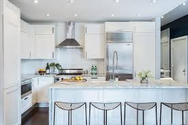 white kitchen cabinets with gray and white marble countertops