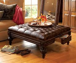 leather tufted square ottoman coffee table and wood floors with floor lamp
