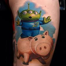 New School Tattoo With Toy Story And Alien