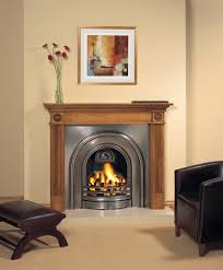 stovax decorative arched insert fireplace with georgian wood mantel fully polished