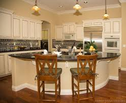 Traditional Antique White Kitchen Cabinets with curved kitchen island