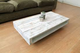 on wheels wood coffee table with a