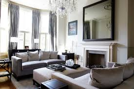 interior large mirror with black wooden frame placed on the white wall above fireplace plus