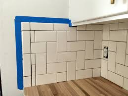 spread grout onto tiles into gaps using a grout float flexible spreader or other tool for wall tile i found the grout float was very frustrating and