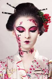 playing a geisha airbrush makeup inspired by a traditional anese style of theater kabuki a thick white electric face to create a dramatic look with