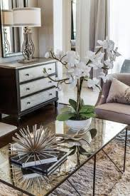 transitional living room furniture. pretty white orchid adorns mercury glass coffee table home decor transitional living room furniture